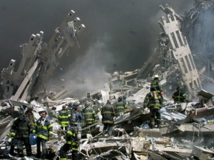 In this Sept. 11, 2001 file photo, firefighters make their way through the rubble after two airliners crashed into the World Trade Center in New York bringing down the landmark buildings. The White House lashed out at Congress on Thursday, Sept. 29, 2016, a day after Republicans and Democrats overwhelmingly …