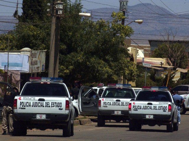 Sonora state police man a roadblock days after a gunbattle between police and a drug cartel assault force that overran a town last May 16 near the Arizona border that left 23 dead, including five police officers in the town of Cananea, Mexico, Friday May 18, 2007. The nation's top …