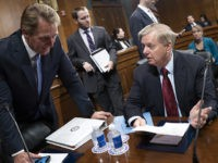 Sen. Jeff Flake, R-Ariz., left, speaks with Sen. Lindsey Graham, R-S.C., as the Senate Judiciary Committee advances a bipartisan bill to protect special counsel Robert Mueller should President Donald Trump try to fire him, on Capitol Hill in Washington, Thursday, April 26, 2018. The Special Counsel Independence and Integrity Act …