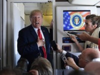 President Donald Trump talks to reporters while in flight from Billings, Mont., to Fargo, N.D., Friday, Sept. 7, 2018. (AP Photo/Susan Walsh)