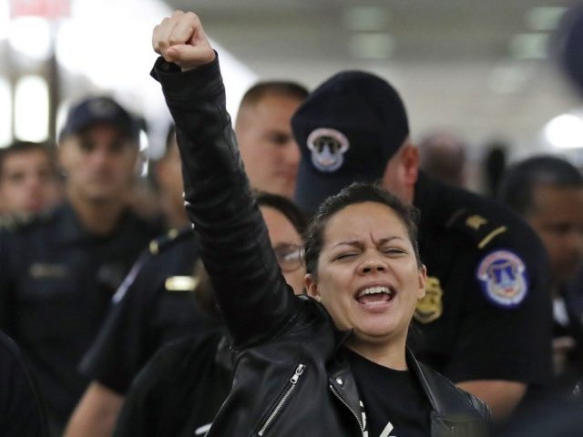 A protester reacts as she is arrested by Capitol Hill Police during a protest against Judge Brett Kavanaugh outside the office of Sen. Susan Collins, R-Maine, on Capitol Hill, Monday, Sept. 24, 2018 in Washington. A second allegation of sexual misconduct has emerged against Judge Brett Kavanaugh, a development that …