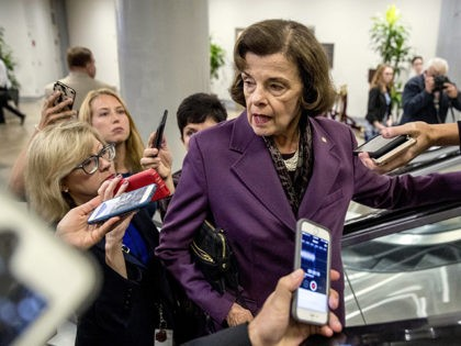 Sen. Dianne Feinstein, D-Calif., speaks to reporters as she walks through the Senate Subway as she arrives for a policy luncheon on Capitol Hill in Washington, Tuesday, Sept. 25, 2018. (AP Photo/Andrew Harnik)