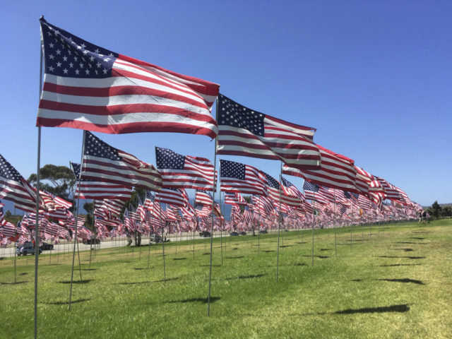 Thousands of flags representing each of the 9/11 terrorist attack victims wave on lawn overlooking the Pacific at Pepperdine University in Malibu, Calif., on Sunday, Sept. 8, 2019. The display is now an annual tradition. (AP Photo/John Antczak)