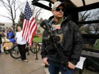 Marty Combs openly carries his AR-15 pistol at a pro gun rally on April 21, 2018 in Boulder, Colorado. The city of Boulder is considering enacting an ordinance that will ban the sale and possession of assault weapons in the city. (Photo by Rick T. Wilking/Getty Images)