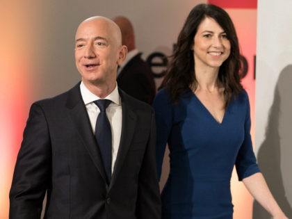 Amazon CEO Jeff Bezos and his wife MacKenzie Bezos arrive at the headquarters of publisher Axel-Springer where he will receive the Axel Springer Award 2018 on April 24, 2018 in Berlin. (Photo by Jörg Carstensen / dpa / AFP) / Germany OUT (Photo credit should read JORG CARSTENSEN/AFP/Getty Images)
