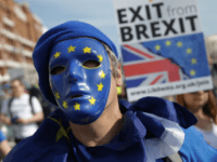 Protesters march along the seafront holding placards and waving European and Union flags in Brighton on September 24, 2017, on a march against Brexit. Britain's revitalised Labour opposition kicks off its annual conference today with leader Jeremy Corbyn set to lay out his party's agenda, free from the leadership challenges …