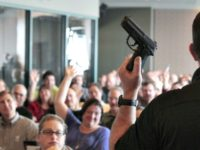 WEST VALLEY CITY, UT - DECEMBER 27: Firearm instructor Clark Aposhian holds a handgun up as he teaches a concealed-weapons training class to 200 Utah teachers on December 27, 2012 in West Valley City, Utah. The Utah Shooting Sports Council said it would waive its $50 fee for concealed-weapons training …