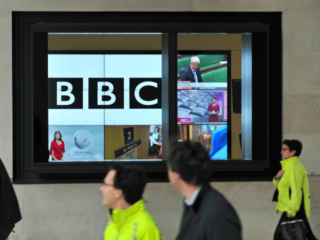 A BBC logo is pictured on a television screen inside the BBC's New Broadcasting House office in central London, on November 12, 2012. The BBC announced that two of its executives were standing aside on Monday and warned more heads may roll as it battles with a major crisis over …