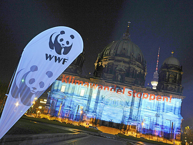 Berlin's cathedral is illuminated with a light installation reading 'Stop the climate change!' and depicting rising water during a light test on November 17, 2008. The installation, organised by the Berliner Dom cathedral and the WWF organisation for environment protection, aims to draw attention on global warming and a sea-level …