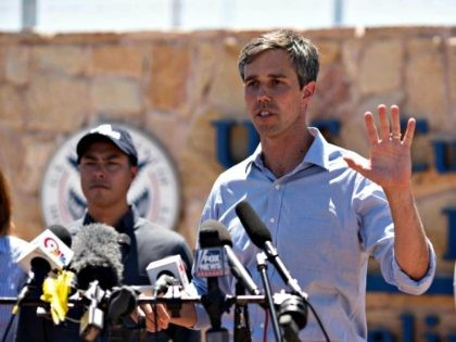 Texas Congressman Beto O'Rourke addresses the press after he and other politicians visited the tent city June 23, 2018 in Tornillo, Texas, housing immigrant children separated from their parents because of the Trump administration's zero tolerance policy. He described the conditions of the camp to be good, but that it …