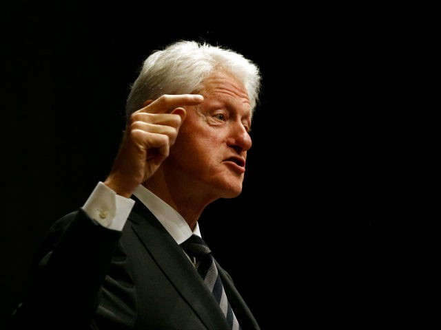 Former President Bill Clinton delivers remarks during a summit on the country's opioid epidemic at the Johns Hopkins Bloomberg School of Public Health in Baltimore, Monday, Oct. 30, 2017. (AP Photo/Patrick Semansky)