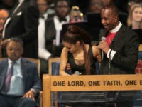Bishop Charles Ellis chats with Ariana Grande after her performance at the funeral for Aretha Franklin at the Greater Grace Temple on August 31, 2018 in Detroit, Michigan. Franklin, 76, died at her home in Detroit on August 16. (Photo by Scott Olson/Getty Images)