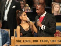 DETROIT, MI - AUGUST 31: Singer Ariana Grande speaks with Bishop Charles Ellis III after performing at the funeral for Aretha Franklin at the Greater Grace Temple on August 31, 2018 in Detroit, Michigan. Franklin died at the age of 76 at her home in Detroit on August 16. (Photo …