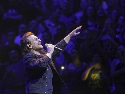 """Singer Bono, of the band U2, performs on stage during the """"eXPERIENCE + iNNOCENCE Tour"""" at Capitol One Arena on Sunday, June, 17, 2018, in Washington. (Photo by Brent N. Clarke/Invision/AP)"""