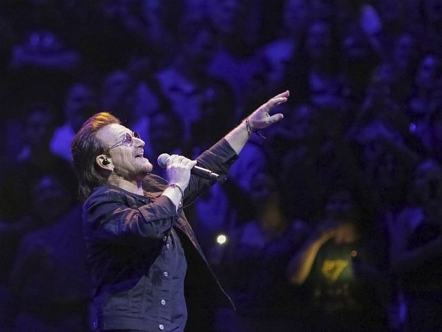 "Singer Bono, of the band U2, performs on stage during the ""eXPERIENCE + iNNOCENCE Tour"" at Capitol One Arena on Sunday, June, 17, 2018, in Washington. (Photo by Brent N. Clarke/Invision/AP)"