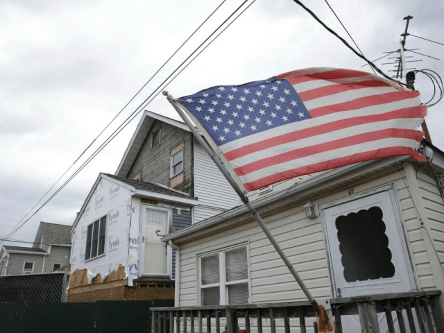 Construction workers repair homes in Broad Channel, New York, on October 26, 2017. According to Census data Wednesday, the median annual household income in the United States climbed nearly 2 percent in 2017, to just under $61,400. File Photo by John Angelillo/UPI