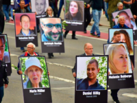 Demonstrators hold up placards showing portraits of victims of refugees during a protest organised by the far-right Alternative for Germany (AfD) party, on September 1, 2018 in Chemnitz, eastern Germany. - The demonstration was organised in a reaction to a knife killing, allegedly by an Iraqi and a Syrian, that …