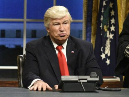 "FILE - This Feb. 4, 2017 file photo released by NBC shows Alec Baldwin portraying President Donald Trump in the opening sketch of ""Saturday Night Live,"" in New York. Baldwin doesn't expect to take his impression of President Trump from ""Saturday Night Live"" to the annual White House Correspondents' Association …"