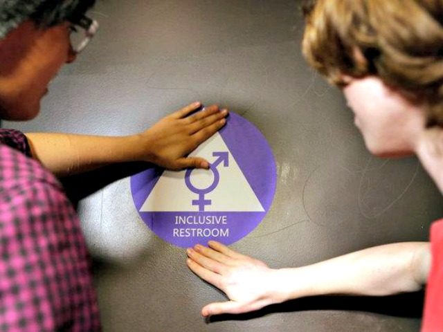 Students placed a sticker on the door of a new gender-neutral bathroom at Nathan Hale High School in Seattle on Tuesday.