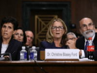 Christine Blasey Ford (C) is flanked by her attorneys Debra Katz (L) and Michael Bromwich as she testifies before the Senate Judiciary Committee in the Dirksen Senate Office Building on Capitol Hill September 27, 2018 in Washington, DC. A professor at Palo Alto University and a research psychologist at the …