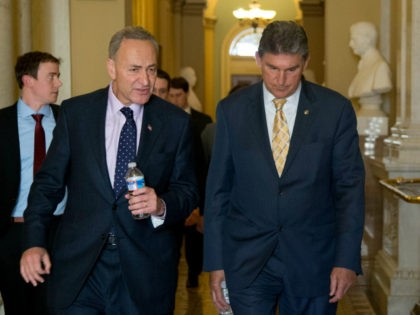 Sens. Chuck Schumer, D-N.Y. left, and Joe Manchin, D-W.Va., walk in the Capitol following a meeting at Senate Majority Leader Harry Reid's, D-Nev., office on Capitol Hill in Washington, Tuesday, April 9, 2013, after a meeting on gun control. Reid's determination to stage a vote came despite continued inconclusive talks …