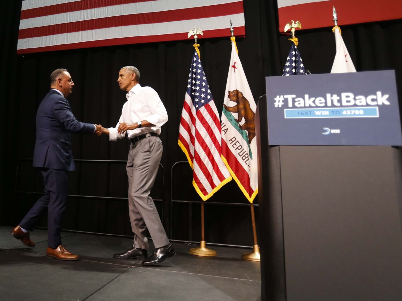 Cisneros greets Obama (Ringo H.W. Chiu / Associated Press)