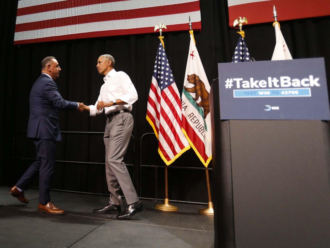 Cisneros greets Obama (Ringo H.W. Chiu / Associated Press)