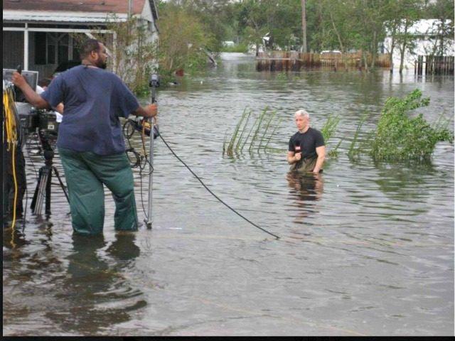 Cooper waist deep in hurricane water