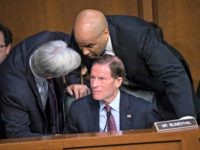 Sen. Sheldon Whitehouse, D-R.I., left, and Sen. Cory Booker, D-N.J., confer with Sen. Richard Blumenthal, D-Conn., seated, as Democrats on the Senate Judiciary Committee appeal to Chairman Chuck Grassley, R-Iowa, to delay the confirmation hearing of President Donald Trump's Supreme Court nominee, Brett Kavanaugh, on Capitol Hill in Washington, Tuesday, …