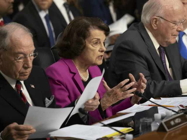 Sen. Dianne Feinstein, D-Calif., the ranking member on the Senate Judiciary Committee, flanked by Chairman Chuck Grassley, R-Iowa, left, and Sen. Patrick Leahy, D-Vt., right, makes an opening statement at the confirmation hearing of President Donald Trump's Supreme Court nominee, Brett Kavanaugh, on Capitol Hill in Washington, Tuesday, Sept. 4, …