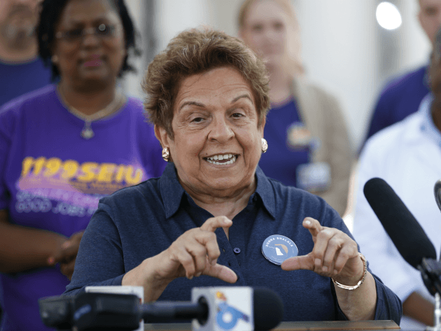 Florida Democratic congressional candidate Donna Shalala gestures as she speaks during a news conference against a Republican lawsuit that seeks to end protections for Americans with pre-existing conditions, at the Ryder Trauma Center at Jackson Memorial Hospital, Wednesday, Sept. 5, 2018, in Miami. (AP Photo/Wilfredo Lee)