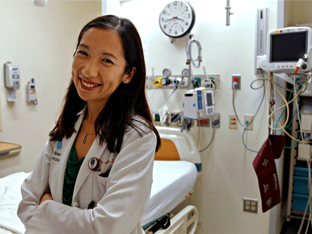 Dr. Leana Wen stands in the emergency department at Brigham and Women's Hospital in Boston, during her medical residency. On Wednesday, Sept. 12, 2018, Wen, an immigrant from China who has been Baltimore's health commissioner for nearly four years, was named as the new president of Planned Parenthood.