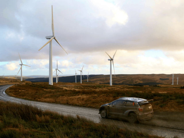 Norwegian pilot Andreas Mikkelssen and his Norwegian co-pilot Ola Floene drive their Volkswagen Motorsport II Polo R WRC during Special Stage 6 of the Wales Rally GB, the final round of the FIA World Rally Championship, at Myherin near Newtown, mid Wales, on November 13, 2015. AFP PHOTO / GEOFF …