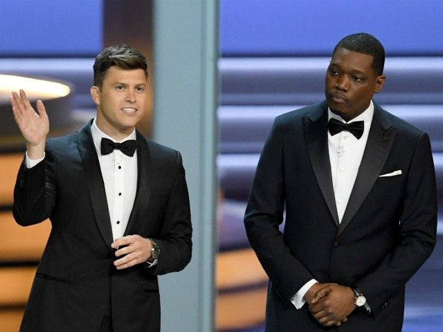 Colin Jost (L) and Michael Che speak onstage during the 70th Emmy Awards at Microsoft Theater on September 17, 2018 in Los Angeles, California. (Photo by Kevin Winter/Getty Images)