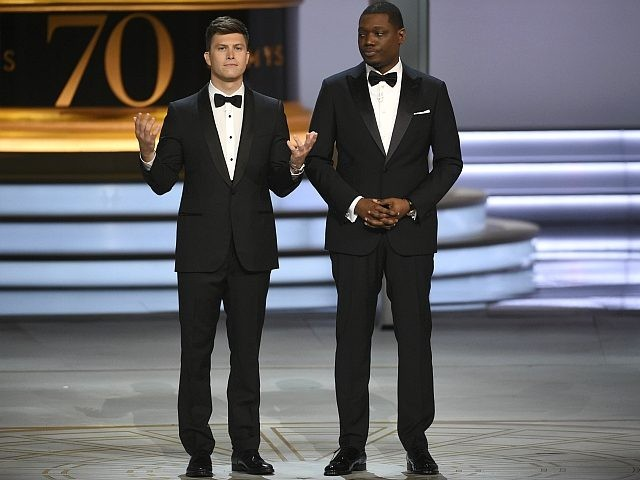 Hosts Colin Jost, left, and Michael Che speak at the 70th Primetime Emmy Awards on Monday, Sept. 17, 2018, at the Microsoft Theater in Los Angeles. (Photo by Phil McCarten/Invision for the Television Academy/AP Images)