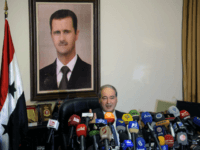 This photo released by the Syrian official news agency SANA, Syrian Deputy Foreign Minister Faisal Mekdad, speaks during a news conference in Damascus, Syria, Saturday, March 10, 2018. Mekdad denied opposition charges that government forces used poison gas in their attacks on eastern Ghouta. Mekdad added that insurgents groups in …