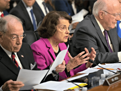 Senate Supreme Court Sen. Dianne Feinstein, D-Calif., the ranking member on the Senate Judiciary Committee, flanked by Chairman Chuck Grassley, R-Iowa, left, and Sen. Patrick Leahy, D-Vt., right, makes an opening statement at the confirmation hearing of President Donald Trump's Supreme Court nominee, Brett Kavanaugh, on Capitol Hill in Washington, …