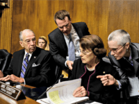 Chairman of the Senate Judiciary Committee Charles Grassley, R-Iowa., , left, and ranking member Sen. Dianne Feinstein, D-Calif., huddle with aides during the Senate Judiciary Committee hearing with Christine Blasey Ford, Thursday, Sept. 27, 2018 on Capitol Hill in Washington.