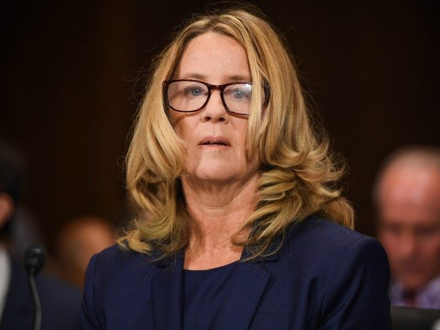 Christine Blasey Ford, the woman accusing Supreme Court nominee Brett Kavanaugh of sexually assaulting her at a party 36 years ago, testifies during his US Senate Judiciary Committee confirmation hearing on Capitol Hill in Washington, DC, September 27, 2018. (Photo by SAUL LOEB / POOL / AFP) (Photo credit should …