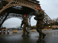 PARIS, FRANCE - JANUARY 09: Armed security patrols around the Eiffel Tower on January 9, 2015 in Paris, France. A huge manhunt for the two suspected gunmen in Wednesday's deadly attack on Charlie Hebdo magazine has entered its third day. (Photo by Dan Kitwood/Getty Images)