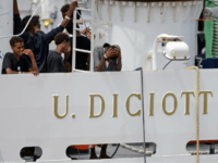 Migrants gather on the deck of the Italian Coast Guard vessel 'Diciotti' in the Sicilian port of Catania, on August 23, 2018, as they wait to disembark following a rescue operation at sea. - The Diciotti vessel rescued the migrants six days ago but Italy's far-right Interior Minister Matteo Salvini …