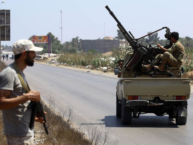 Libyan security forces patrol on August 23, 2018 near the site of an attack on a checkpoint in the city of Zliten, 170 km east of the capital Tripoli. - An attack on a checkpoint between the Libyan capital and the town of Zliten killed six soldiers of the UN-backed …
