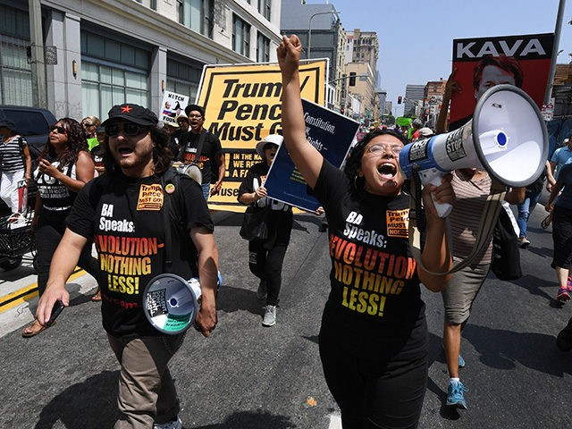 Demonstrators march through the city streets during the 'Unite For Justice' rally in protest of judge Brett Kavanaugh's confirmation to the US Supreme Court, in Los Angeles, California on August 26, 2018. (Photo by Mark RALSTON / AFP) (Photo credit should read MARK RALSTON/AFP/Getty Images)