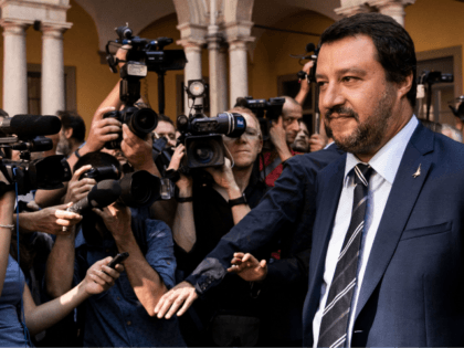 Italy's Interior Minister Matteo Salvini (R) looks on as he walks among media representatives before the arrival of Hungary's Prime Minister Viktor Orban, ahead of a meeting in Milan on August 28, 2018. (Photo by MARCO BERTORELLO / AFP) (Photo credit should read MARCO BERTORELLO/AFP/Getty Images)