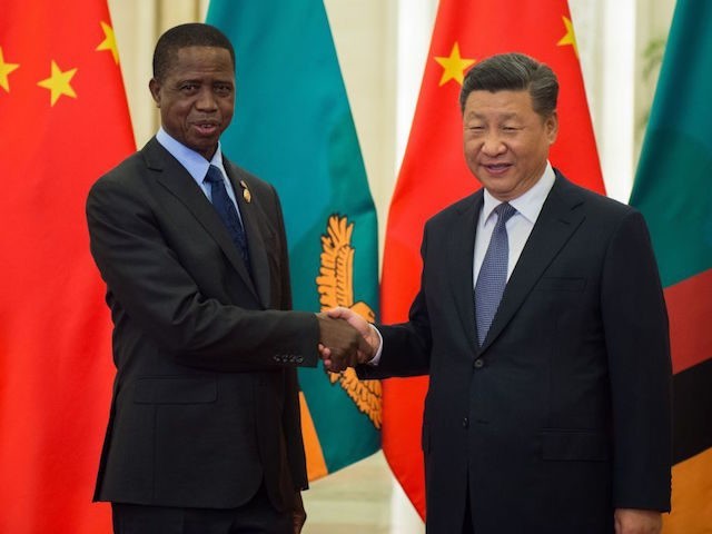 Zambia's President Edgar Lungu (L) shakes hands with China's President Xi Jinping before their bilateral meeting at the Great Hall of the People on September 1, 2018. - Lungu is in China for the Forum on China-Africa Cooperation which will be held in Beijing on September 3 and 4. (Photo …