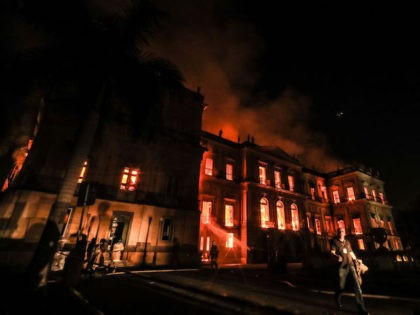 RIO DE JANEIRO, BRAZIL - SEPTEMBER 02: A fire burns at the National Museum of Brazil on September 2, 2018 in Rio de Janeiro, Brazil. The museum, which is tied to the Rio de Janeiro federal university and the Education Ministry, was founded in 1818 by King John VI of …