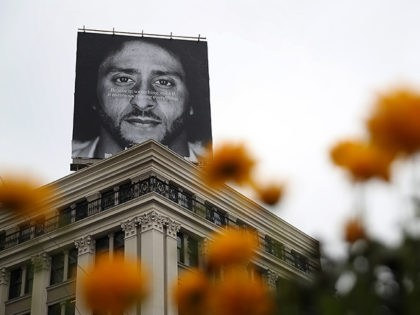 """SAN FRANCISCO, CA - SEPTEMBER 05: A billboard featuring former San Francisco 49ers quaterback Colin Kaepernick is displayed on the roof of the Nike Store on September 5, 2018 in San Francisco, California. Nike launched an ad campaign to commemorate the 30th anniversary of its iconic """"Just Do It' motto …"""