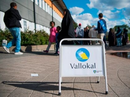 People arrive to vote in the Swedish general elections at a polling station in the suburb of Rinkeby, north of Stockholm on September 9, 2018. (Photo by Jonathan NACKSTRAND / AFP) (Photo credit should read JONATHAN NACKSTRAND/AFP/Getty Images)