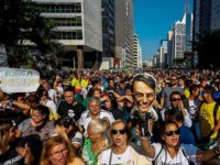 Supporters of Brazilian right-wing presidential candidate Jair Bolsonaro attend a rally at Paulista Avenue in Sao Paulo, Brazil on September 09, 2018. - Supporters of conservative presidential candidate Jair Bolsonaro demonstrated in support of the frontrunner on Sunday, who is convalescing after being stabbed while campaigning several days before. Bolsonaro …