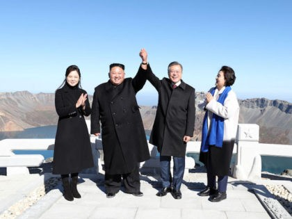 MOUNT PAEKTU, NORTH KOREA - SEPTEMBER 20: (EDITORIAL USE ONLY, NO COMMERCIAL USE) North Korean leader Kim Jong Un (2nd L) and his wife Ri Sol Ju (L) pose with South Korean President Moon Jae-in (2nd R) and his wife Kim Jung-sook (R) on the top of Mount Paektu on …